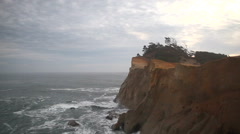 Panning Movie of Crashing Waves with Clouds in Cape Kiwanda in Pacific City OR Stock Footage