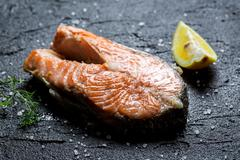 freshly fried salmon served with dill and lemon - stock photo