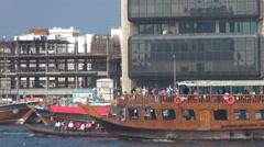 Pan left touristic boat Deira Creek River sunny day abra transportation Dubai  Stock Footage
