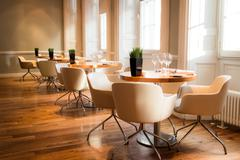 Interior of an exclusive restaurant with light from windows Stock Photos
