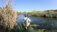 Back view of fly fisherman in river Stock Footage