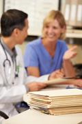 Patient records on desk at nurses station Stock Photos