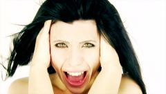 Woman screaming like crazy with wind blowing in her hair isolated closeup - stock footage