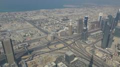 Timelapse aerial view Dubai business skyscraper traffic street freeway sunny day Stock Footage