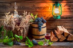 Grapes and red wine in a demijohn Stock Photos