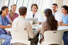 Medical team discussing treatment options with patients Stock Photos