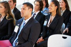 Audience listening to presentation at conference Stock Photos