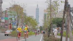 Stock Video Footage of People riding bike at Da-an park - Taipei 101