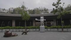 Stock Video Footage of The frog statue at Da-an park sunken garden