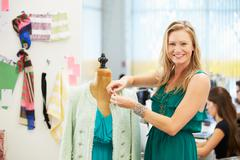 Fashion designer in studio Stock Photos
