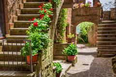 old town full of flowery porches in tuscany - stock photo