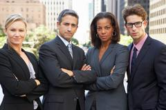 Portrait of four business colleagues outside office Stock Photos