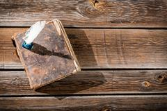 old book and a fountain pen with ink - stock photo