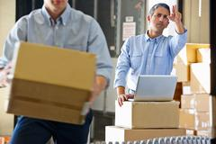 Workers in distribution warehouse Stock Photos