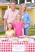 Family Running Charity Bake Sale Stock Photos