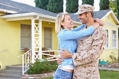 Wife Welcoming Husband Home On Army Leave Stock Photos