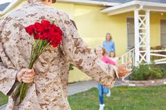 Family welcoming husband home on army leave Stock Photos