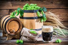 dark beer straight from the barrel - stock photo