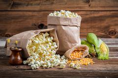 Corn and popcorn in rustic version Stock Photos