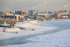 Winter cityscape on the Irtysh River. Center of Omsk. - stock photo