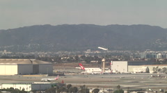 Plane taking off at LAX Stock Footage