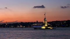 Kiz Kulesi in the early evening as the sun sets over the Bosphorus Sea Stock Footage