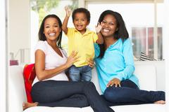 Woman visiting pregnant friend with son at home Stock Photos
