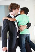 Son greets father on return from work Stock Photos