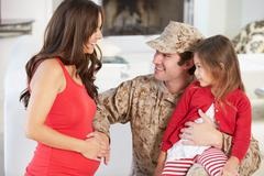 Family greeting military father home on leave Stock Photos