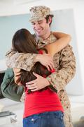 Wife greeting military husband home on leave Stock Photos