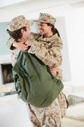 Military couple greeting each other on home leave Stock Photos