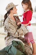 Daughter greeting military mother home on leave Stock Photos