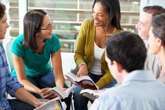 Bible group reading together Stock Photos