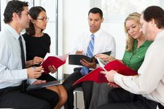 Businesspeople having informal office meeting Stock Photos
