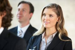 Businesswoman listening to speaker at conference Stock Photos