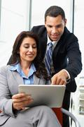 Businesspeople with digital tablet during informal meeting Stock Photos