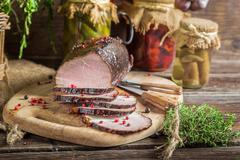 freshly sliced ??smoked ham and marjoram - stock photo