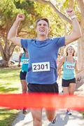 Male runner winning marathon Stock Photos