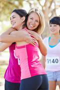 Female runners congratulating one another after race Stock Photos
