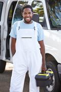 Portrait of repairman with van Stock Photos