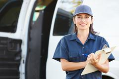 Portrait of female delivery driver with clipboard Stock Photos