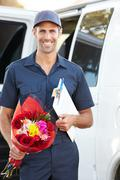 Portrait of delivery driver with flowers Stock Photos