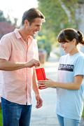 Charity worker collecting from man in street Stock Photos