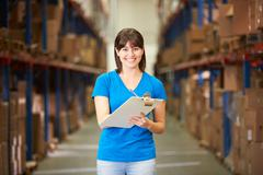 Female worker in distribution warehouse Stock Photos