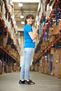 Rear view of female worker in distribution warehouse Stock Photos
