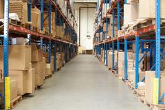 Interior of warehouse with goods on shelves Stock Photos