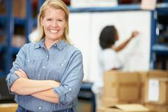 portrait of worker in distribution warehouse - stock photo