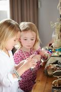 Two girls playing with jewelry and make up Stock Photos