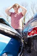 Driver Inspecting Damage After Traffic Accident Stock Photos
