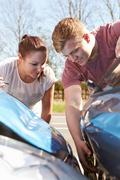 Two Drivers Inspecting Damage After Traffic Accident Stock Photos